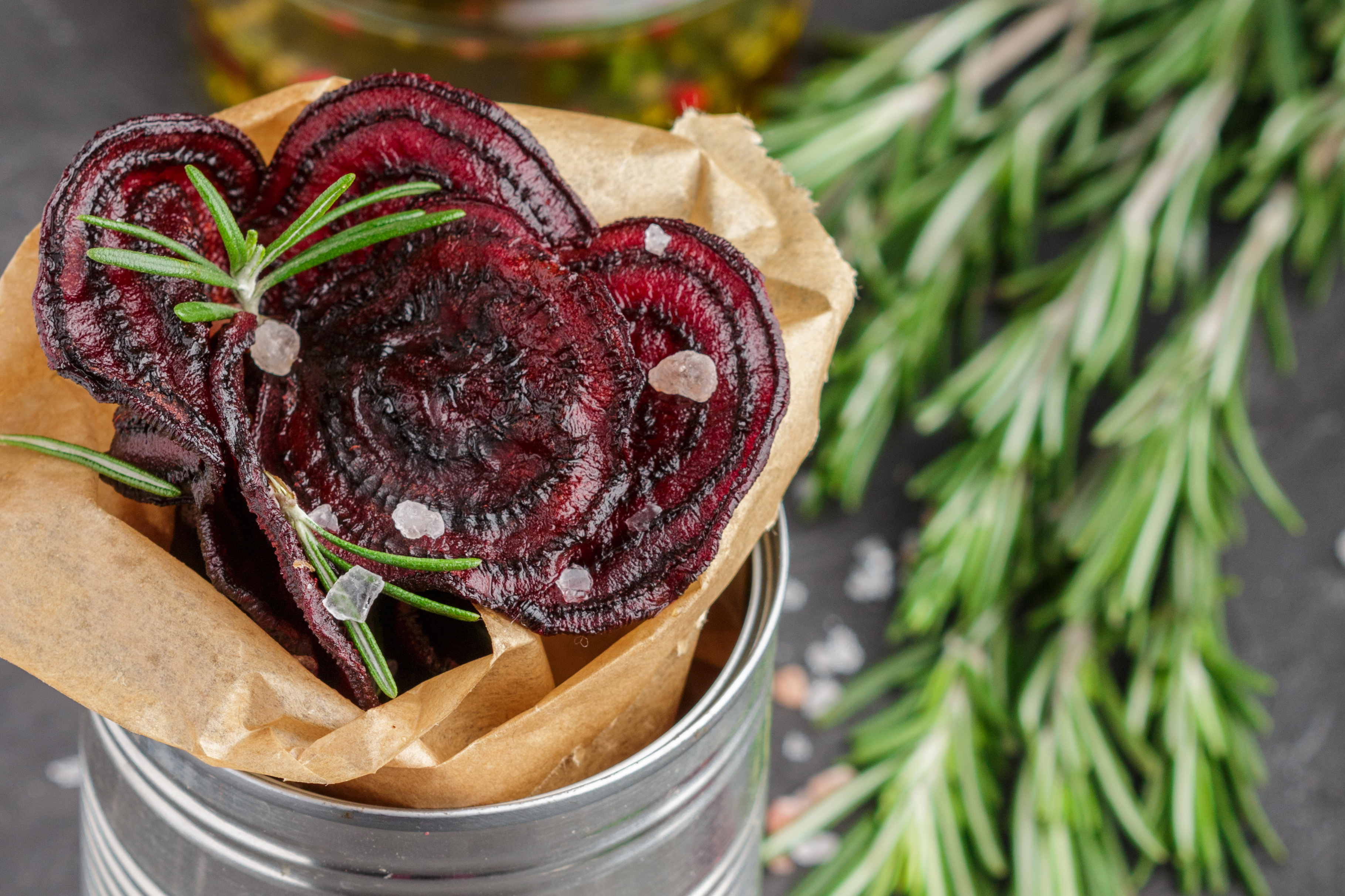 Healthy beetroot chips  with salt and rosemary. Snack for gourme